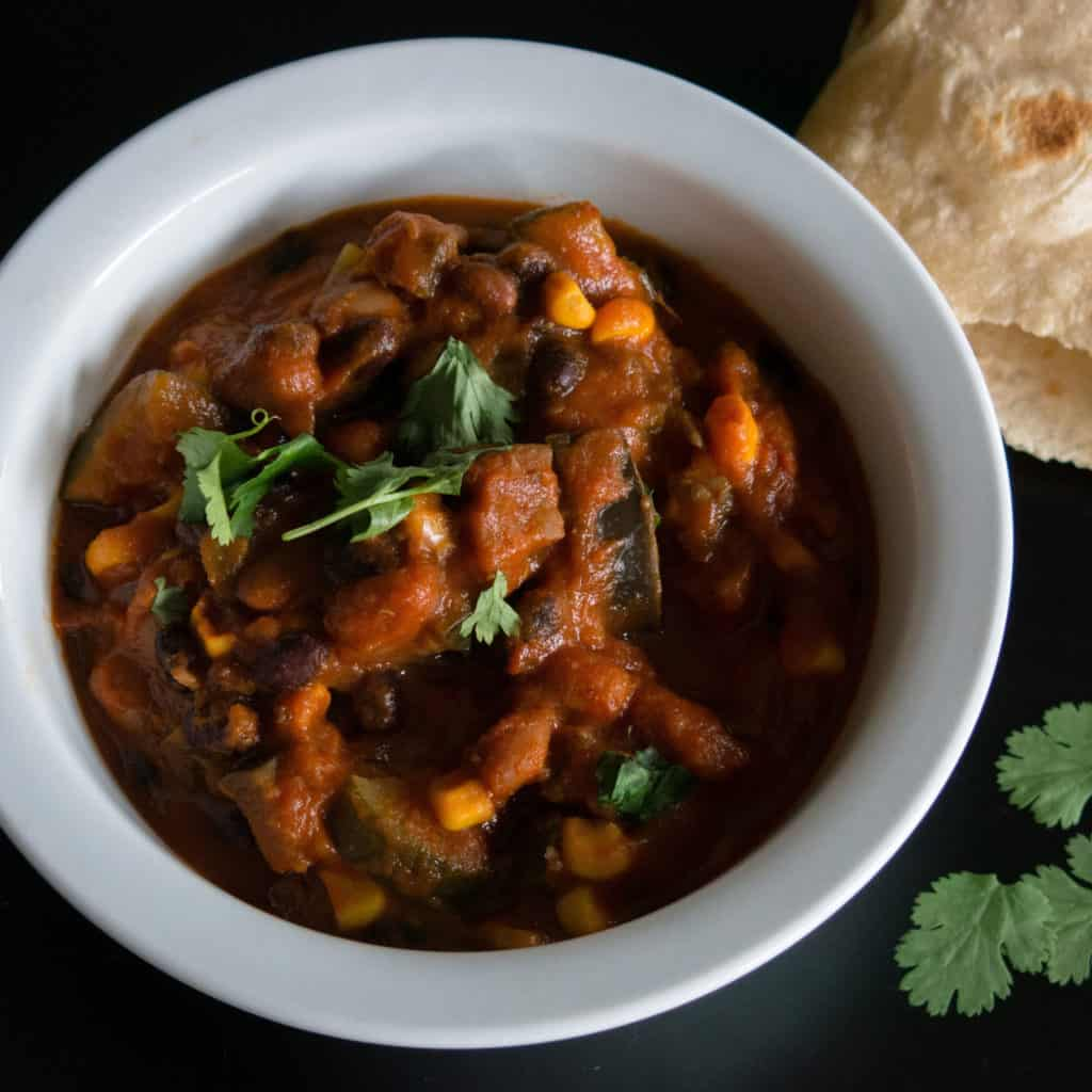 Gluten free, vegan chilli sin carne. Vegetable chilli. Rich, spicy vegetable chilli. Served with gluten free, vegan tortilla. Steaming and ready to eat.